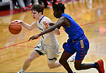 Alton Marquette guard Spencer Cox (left) dribbles past Roxana forward Parris White. Alton Marquette played Roxana in the Class 2A Roxana boys basketball regional final at Roxana High School in Roxana, Illinois on Friday February 28, 2020. <br /> Tim Vizer/Special to STLhighschoolsports.com