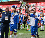 Matt Taylor of Bristol Rovers (2nd left) and Jake Gosling of Bristol Rovers (right) hold the Vanarama Conference Playoff Trophy aloft after victory in the 2015 Vanarama Conference Promotion Final match between Grimsby Town and Bristol Rovers at Wembley Stadium, London<br /> Picture by David Horn/eXtreme aperture photography +44 7545 970036<br /> 17/05/2015