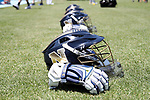 CHAPEL HILL, NC - MAY 20: Navy goalkeeper helmets and gloves are lined up on the sideline. The University of North Carolina Tar Heels hosted the U.S. Naval Academy Midshipmen on May 20, 2017, at Fetzer Field in Chapel Hill, NC in an NCAA Women's Lacrosse Tournament Quarterfinal match. Navy won the game 16-14.