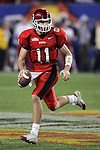 1/1/05 -- Photo by Gene Lower / Slingshot -- Utah quarterback Alex Smith scrambles out of the pocket and looks for a reciever downfield. The Utes won the Fiesta Bowl 35 - 7 against the Pittsburgh Panthers in Phoenix, AZ on 1/1/05.