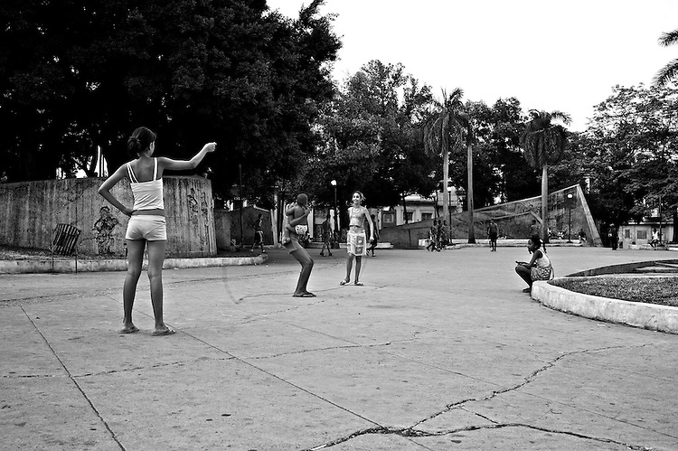 Images from the old Havana, Cuba.  ..Kids playing in the plaza, while teenagers play soccer in the back.  ..Perhaps one of the aspects of society that first standout as you land in Havana, it's how much time people spend in the street, interacting and socializing with other people.  Recent studies in western society have revealed that almost 30% of people interviewed cannot name not even one of their neighbors, and the studies suggests that  technology and e-social interactions are at the root of this pattern.  ..Very little of this is possible in Cuba.  With very limited access to the internet and technology in general, life happens in the street.  Most of the doors of people's home is open pretty much all day, and many will take a chair out and seat, talk and watch people go by.  ..Kids still play like we used to.  A smashed can and a couple of rocks will create the most entertaining game for kids that lack access to a different entertainment experience driven by video games and the internet.