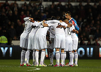 SWANSEA, WALES - MARCH 16: Swansea players huddle prior to the Premier League match between Swansea City and Liverpool at the Liberty Stadium on March 16, 2015 in Swansea, Wales