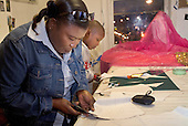 Memebers of Flamboyan carnival group prepare costumes  for the Notting Hill Carnival.