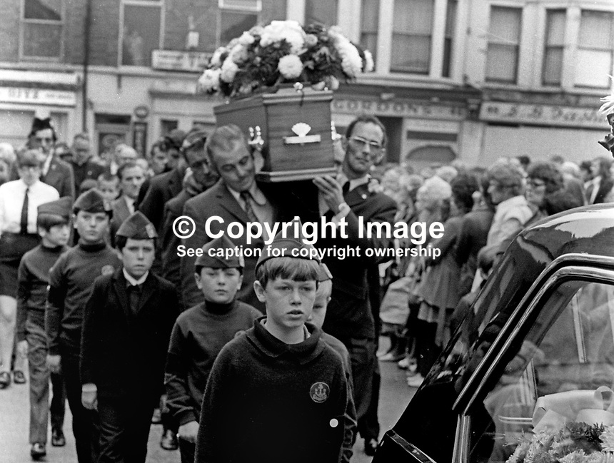 Funeral of missing Belfast, N Ireland, schoolboy, Brian McDermott, whose body was found a week after he went missing between school and home on 2nd September 1973. His coffin is flanked by Boys Brigade members attached to his local church. 197309120582a