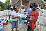 A man receives a package of food and other emergency supplies from the Lutheran World Federation, a member of the ACT Alliance, in the village of Gressier outside of Port-au-Prince, Haiti. A January 12 earthquake ravaged the Caribbean nation, leaving hundreds of thousands hungry and increasingly frustrated and desperate. The material provided here by LWF included material provided by Church World Service, another member of the ACT Alliance.