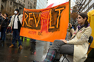December 7, 2011  (Washington, DC)  OccupyDC protesters hold a banner during a march and rally in downtown Washington. Several dozen people were later arrested for blocking the street.   (Photo by Don Baxter/Media Images International)