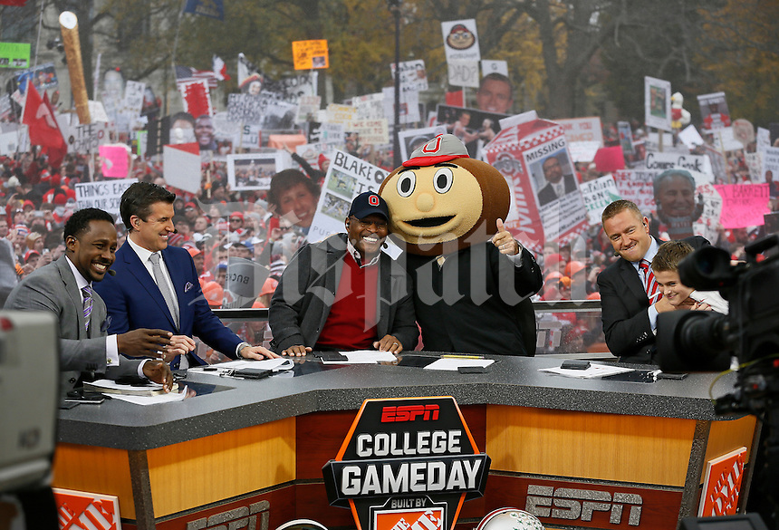 Lee Corso gives the thumbs up after picking Ohio State to win while, from left, Desmond Howard, Rece Davis, Archie Griffin, and Kirk Herbstreit sit on the set of ESPN's College GameDay broadcast from the campus of Ohio State prior to the NCAA football game against the Michigan State Spartans in Columbus on Nov. 21, 2015. (Adam Cairns / The Columbus Dispatch)