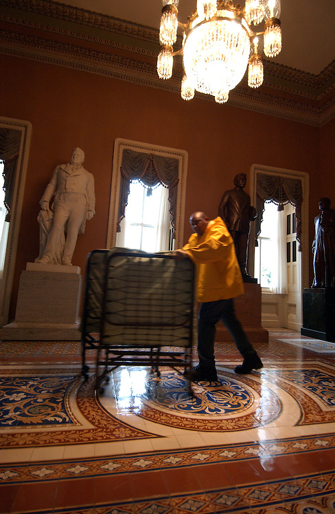 Sergeant at Arms employee James Montgomery weels cots into the Senate . The workers were setting up the cots so the members would have a place to sleep during the all night marathon session to work on confirmation of judges.