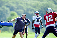 August 1, 2017: New England Patriots head coach Bill Belichick flings a blocking cushion at quarterback Tom Brady (12) at the New England Patriots training camp held at Gillette Stadium, in Foxborough, Massachusetts. Eric Canha/CSM