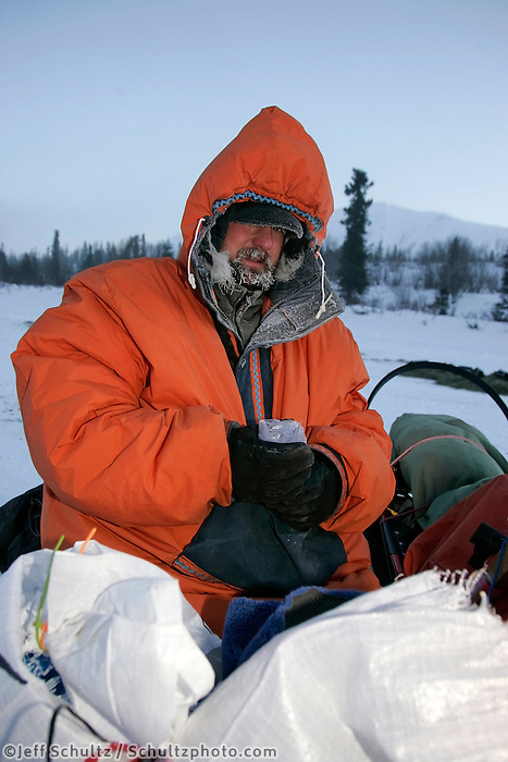 Tuesday March 6, 2007   Rainy Pass checkpoint----  Rich Humm fixes dog food at the Rainy Pass checkpoint on Puntilla Lake at 20 below zero with 15-20 mph winds on Tuesday morning