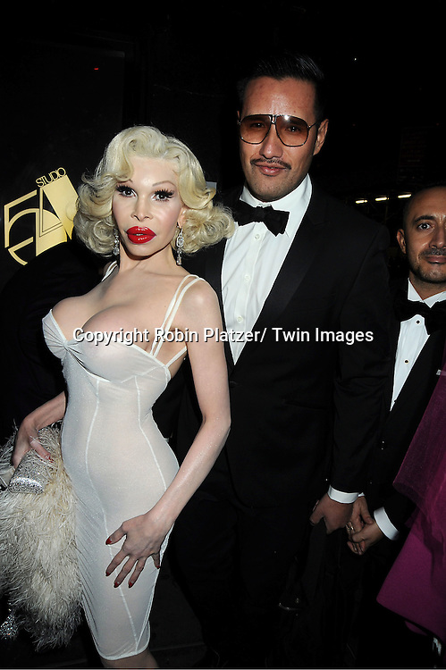 """Amanda LePore and guest attends the SiriusXM Reopens Studio 54 for """"One Night Only"""" party on October 18, 2011 at Studio 54 in New York City."""