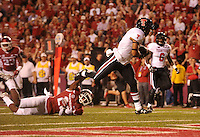 NWA Democrat-Gazette/MICHAEL WOODS • @NWAMICHAELW<br /> Texas Tech running back Justin Stockton dives into the end zone for a touchdown past Arkansas defender Josh Liddell in the 3rd quarter of Saturday nights game against the Razorbacks at Razorback Stadium in Fayetteville.