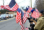 WATERBURY CT. 31 December 2018-123118SV08-Flag wavers line East Main Street as the hearse carrying Zeqir &quot;Ziggy the Flag Man&quot; Berisha enters Calvary Cemetery in Waterbury Monday.<br /> Steven Valenti Republican-American
