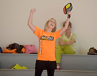 NWA Democrat-Gazette/BEN GOFF @NWABENGOFF<br /> Pat Bantz of Bentonville celebrates point on Monday Nov. 16, 2015 during a game of pickleball at the City of Rogers Senior Wellness Center.