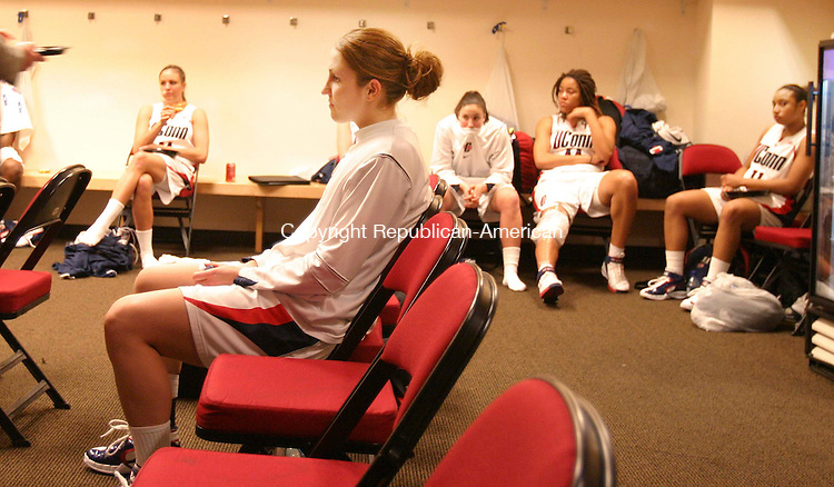 FRESNO, CA. 26 March 2007-032607SV11--Mel Thomas of UConn sits with her team in the locker room after the teams loss to LSU during in the elite eight round of the NCAA tournament at the Save Mart Center in Fresno, CA. Monday.<br /> Steven Valenti Republican-American