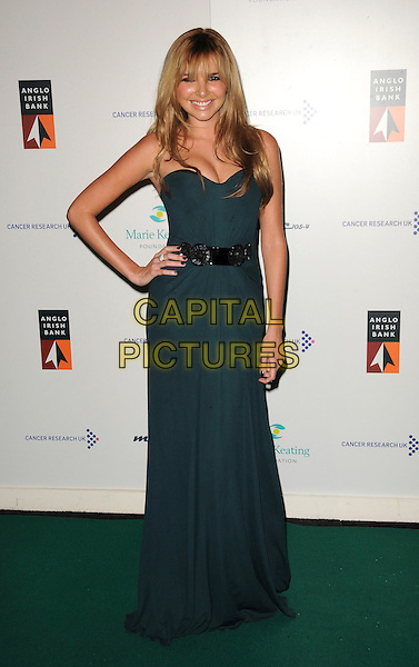 NADINE COYLE  - GIRLS ALOUD .Arrivals - The Emerald & Ivy Ball, Batersea Evolution, London, England, .November 21st 2008..full length green strapless long maxi dress black belt embellished hand on hip long hair fringe .CAP/CAS.©Bob Cass/Capital Pictures