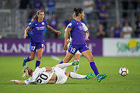 Orlando, FL - Saturday March 24, 2018: Orlando Pride defender Poliana Barbosa Medeiros (19) has the ball ackled away by Utah Royals forward Elise Thorsnes (20) during a regular season National Women's Soccer League (NWSL) match between the Orlando Pride and the Utah Royals FC at Orlando City Stadium. The game ended in a 1-1 draw.