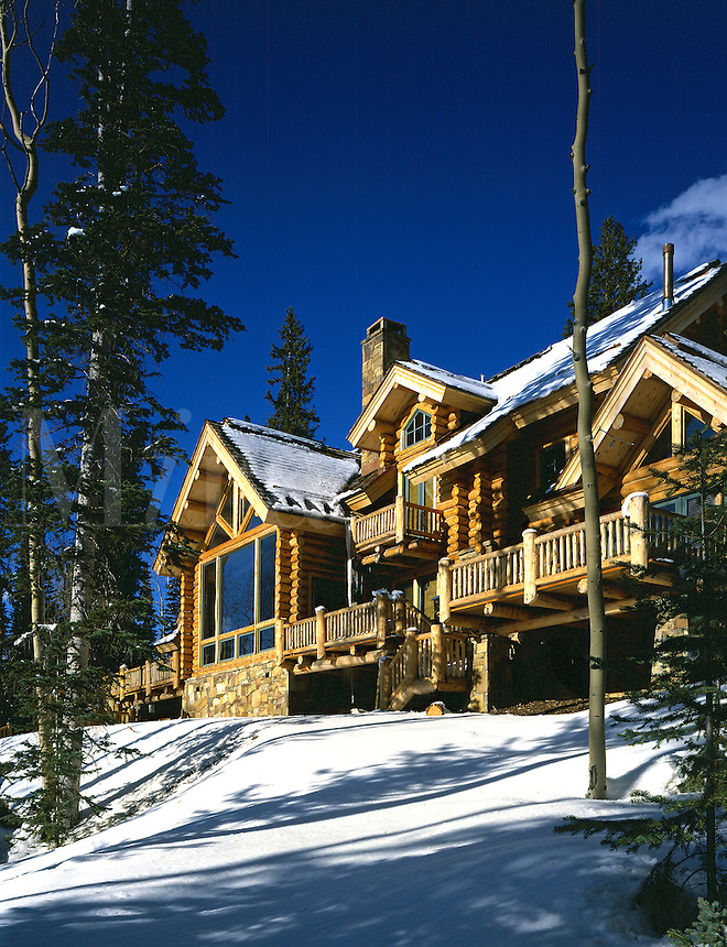 Contemporary log house in snow at Mountain Village, Telluride, CO. Telluride, Colorado.