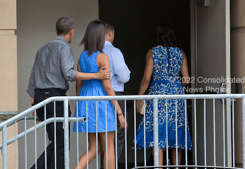 United States President Barack Obama walks with his daughter Malia as they follow first lady Michelle Obama into the Strathmore Music Center in Bethesda, Maryland, on Sunday, June 16, 2013. The Obama's were attending a dance performance with where their daughter Sasha was performing.<br /> Credit: Joshua Roberts / Pool via CNP