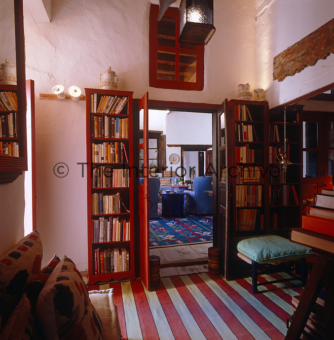 View of the living room from the library's open double door in John Stefanidis home on the Greek island of Patmos