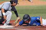 Wildcats' Kody Reynolds dives back safely under the tag of College of Southern Nevada's Ali Deolarte during a game at Western Nevada College in Carson City, Nev., on Thursday, March 26, 2015. <br /> Photo by Cathleen Allison/Nevada Photo Source