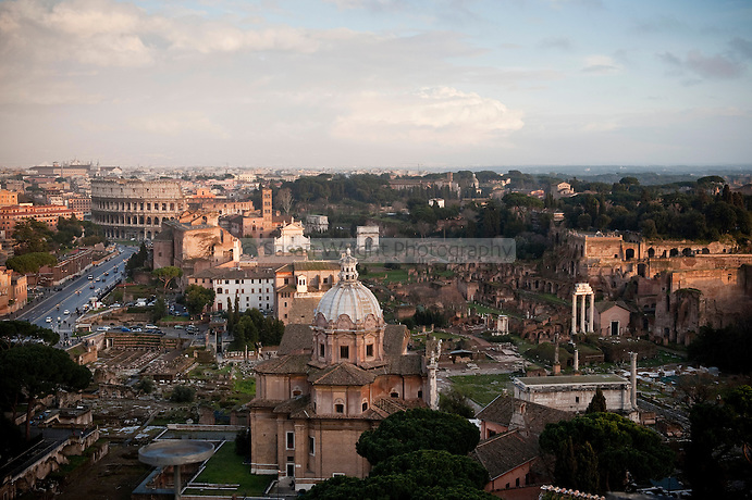 View of the eternal city of Rome - the Imperial Forum, Palatine Hill and the Colosseum, Rome, Italy