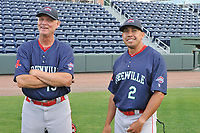 Pitching coach Bob Kipper (13), left, and manager Iggy Suarez (2) of the Greenville Drive look over the field during a preseason workout on Tuesday, April 3, 2018, at Fluor Field at the West End in Greenville, South Carolina. The 2018 season begins Thursday. (Tom Priddy/Four Seam Images)