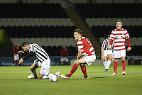 Steven Thompson fouled by Michael Devlin in the St Mirren v Hamilton Academical Scottish Communities League Cup match played at St Mirren Park, Paisley on 25.9.12.