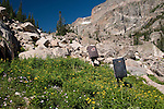women hinking with bouldering pads, Chaos Canyon, sunny, day, summer, morning, Rocky Mountain National Park, Rocky Mountains, Colorado, USA