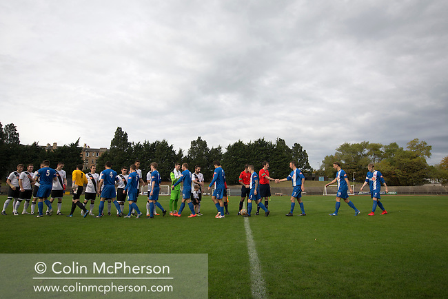 Both sets of players exchanging pre-match handshakes at Meadowbank Stadium in Edinburgh, before Edinburgh City (in white) played host to Spartans in a Lowland League fixture. The host won the match 1-0 with a late goal by Ousman See, despite playing for the last 30 minutes with 10 men after Ross Allum was sent off. The wind kept the reigning champions side clear at the top of the league.