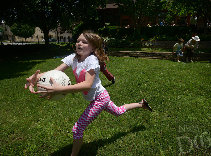 NWA Democrat-Gazette/BEN GOFF @NWABENGOFF<br /> London West, 10, of Fayetteville, catches the ball during a game of Newcomb ball on Sunday June 5, 2016 during a parish picnic after service at St. Paul's Episcopal Church in Fayetteville.