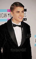 LOS ANGELES, CA - NOVEMBER 20: Justin Bieber arrive at the 2011 American Music Awards held at Nokia Theatre L.A. LIVE on November 20, 2011 in Los Angeles, California.