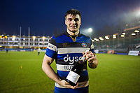 Man of the Match Josh Bayliss poses with his bottle of champagne after the match. Anglo-Welsh Cup match, between Bath Rugby and Newcastle Falcons on January 27, 2018 at the Recreation Ground in Bath, England. Photo by: Patrick Khachfe / Onside Images