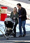 ..Novemeber 2nd 2011   Exclusive ...Christina Applegate & Will Arnett filming the tv show Up All Night in Los Angeles California. Christina drank some water & showed up her post baby bump belly. Christina was wearing a pink & gray striped shirt & green army jacket while filming a Christmas scene with fake snow & presents while pushing a baby stroller. The entire camera crew was making funny faces trying to get the baby to laugh for the camera shot. ...AbilityFilms@yahoo.com.805-427-3519.www.AbilityFilms.com..