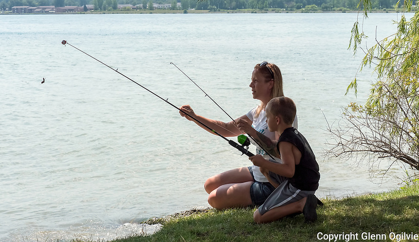 A staycation wouldn't be complete without a fishing trip to Talfourd Creek, in Froomfield. After hitting all the Lambton County hot spots the families of Dave Page, of Courtright and Corrie Boucher, of Sarnia capped off the week long holidays fishing by the St. Clair River. Here Ben Page, 7, gets a helping hand to bait the hook from Corrie Boucher.