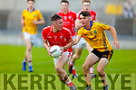 East Kerry's Sean O'Leary in possession under the watchful eyes of Ciaran Pierse of Feale Rangers in the County U21 Football Final in Austin Stack Park on Thursday.