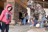 Erik Glazier of Rogers (right) saws wood for a fire as Gabe Gifford, 7, of Rogers watches (left), Sunday, March 15, 2020 during a picnic at the Lake Atalanta pavilion in Rogers. Check out nwaonline.com/200316Daily/ for today's photo gallery.<br /> (NWA Democrat-Gazette/Charlie Kaijo)<br /> <br /> Employees of the Rogers based companies IT'S Plumbing and Electric and Smooth Touch Remodel held a picnic for members of the three companies to connect around a warm meal.