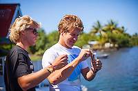 Teahupoo, Tahiti Iti, French Polynesia. Tuesday 14 August 2012. Pat Gudauskas (USA) and Austin Ware (USA) trying their hand at fishing.  The swell had backed off today to around 2' and an onshore NW wind made Teahupoo virtually unsurfable. Photo: joliphotos.com