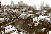 Mar 4, 2006; Tokyo, JPN; Tsukiji.Traffic at the Tsukiji Market...There are literally hundreds of vehicles, bikes, scooters, motorized carts and pedestrians going in and out of the Tsukiji Market every hour in the early morning...Photo credit: Darrell Miho