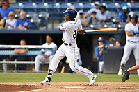 Asheville Tourists Daniel Montano (24) swings at a pitch during a game against the Lakewood BlueClaws at McCormick Field on August 4, 2019 in Asheville, North Carolina. The Tourists defeated the BlueClaws 13-6. (Tony Farlow/Four Seam Images)