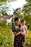 BELIZE, Punta Gorda, Toledo District, Nilsa Col holds her sister Wendy in front of their home in the Maya village of San Jose