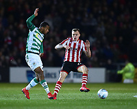 Yeovil Town's Josh Grant clears under pressure from Lincoln City's Harry Anderson<br /> <br /> Photographer Andrew Vaughan/CameraSport<br /> <br /> The EFL Sky Bet League Two - Lincoln City v Yeovil Town - Friday 8th March 2019 - Sincil Bank - Lincoln<br /> <br /> World Copyright © 2019 CameraSport. All rights reserved. 43 Linden Ave. Countesthorpe. Leicester. England. LE8 5PG - Tel: +44 (0) 116 277 4147 - admin@camerasport.com - www.camerasport.com
