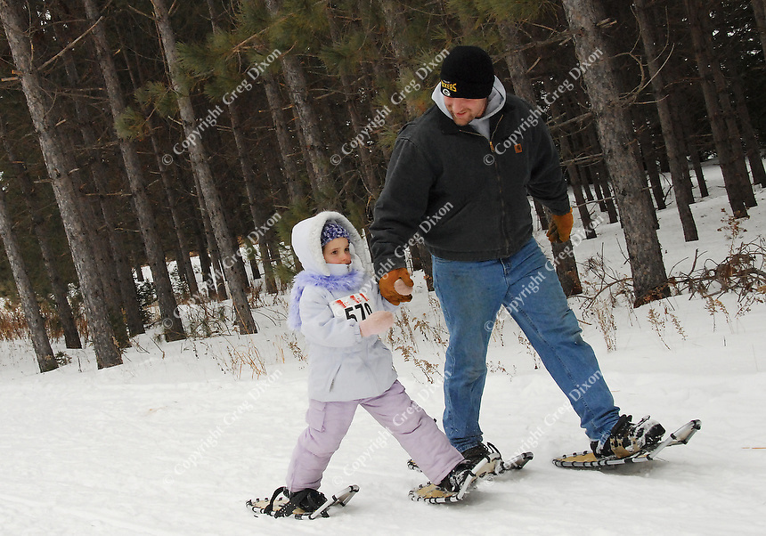 Athletes of all ages compete in the snowshoe event of the Badger State Winter Games at Nine Mile Forest in Wausau on Sunday
