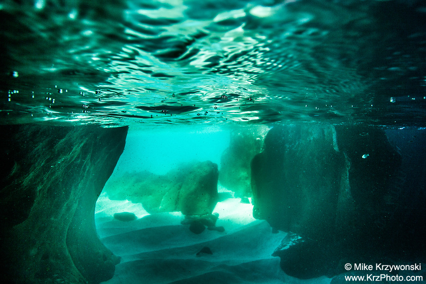 Underwater view looking out of a sea cave at Waimea Bay, Oahu