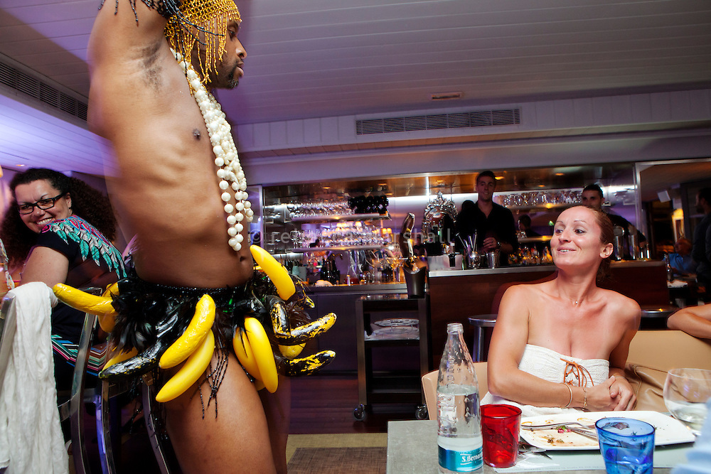 Performance artist, dancer and singer Brian creates a lively late-night atmosphere at restaurant La Cantine, A'Trego, Cap d'Ail, France, 5 July 2013