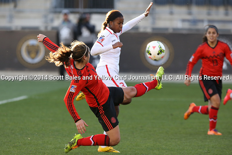 26 October 2014: Alina Garciamendez (MEX) (4) tries to clear the ball away from Mariah Shade (TRI) (3). The Trinidad & Tobago Women's National Team played the Mexico Women's National Team at PPL Park in Chester, Pennsylvania in the 2014 CONCACAF Women's Championship Third Place game. Mexico won the game 4-2 after extra time. With the win, Mexico qualified for next year's Women's World Cup in Canada and Trinidad & Tobago face playoff for spot against Ecuador.