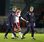 Andy Halliday with medical staff at full-time