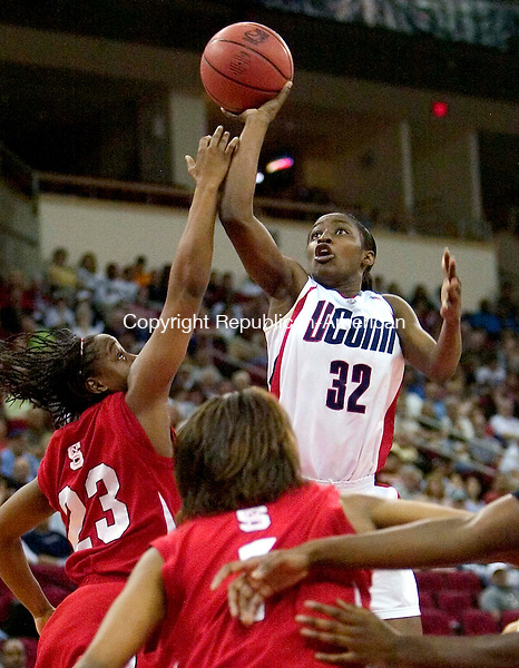 FRESNO, CA. 24 March 2007-032407SV06--#32 Kalana Greene of UConn puts up a shot over #23 Shayla Fields of NC State during the sweet sixteen round of the NCAA tournament at the Save Mart Center in Fresno, CA. Saturday.<br /> Steven Valenti Republican-American