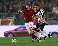 Francesco Totti  challanges  Roberto Pereyra during the Italian Serie A soccer match between   AS Roma and Juventus FC       at Olympic Stadium      in Rome ,March 02 , 2015