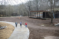 NWA Democrat-Gazette/SPENCER TIREY Diana David, from left, Laura David and Larry Davis wlak the trail through Coler Mountain Bike Preserve South Gateway  Sunday, March 24, 2019 in Bentonville. The new pavilion and parking area is still under construction.